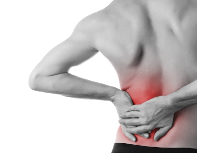 person holding side of lower back in pain